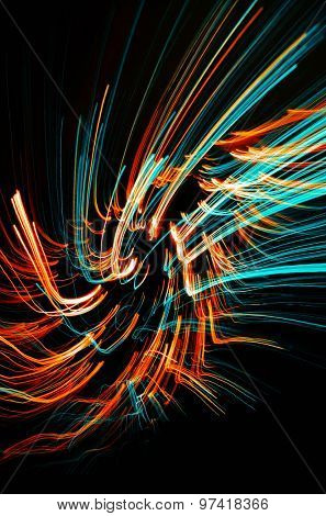 Colorful abstract glowing twirl lines at night