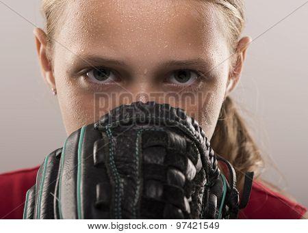 Girl softball player with mitt