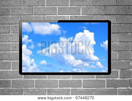 Blank Screen Lcd Tv With Blue Sky Hanging On A Wall