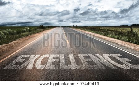 Excellence written on rural road