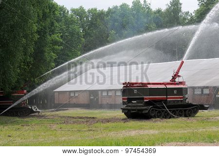 Armored tanks fire GPM-54 on exercises extinguish a fire in a warehouse poster