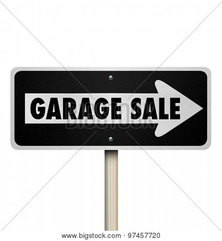 Garage Sale road sign pointing way or direction to a rummage, moving, lawn or resale event in a community or neighborhood