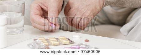 Ill Person Taking Medicine