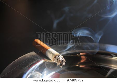 Smoking Cigarette On Ashtray