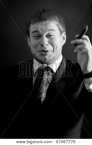 Young  funny  businessman with cigar
