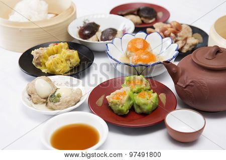 Group Of Stream Dim Sum Chinese Food And Hot Tea