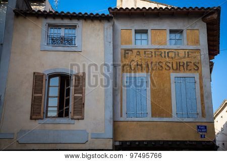 House facades in the old town of L'Isle sur la Sorgue in Provence poster