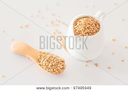 Yellow Flax Seed On Clean Kitchen Table