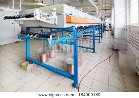 Industrial tinning shop for copper wire. Oven for annealing wire.