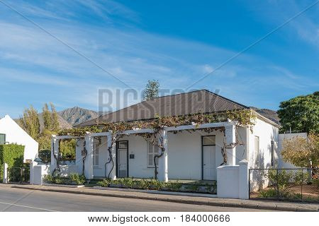 MONTAGU SOUTH AFRICA - MARCH 26 2017: An old house with grape vine verandah in Montagu a town in the Western Cape Province