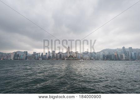 HONG KONG - JANUARY 9 2016: Hongkong Cityscape Victoria Harbour Hongkong Business Center District Hong Kong China