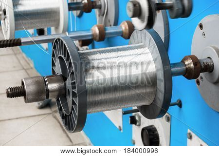 Coils with tinned wire. The spools are wound on an automatic winding machine.