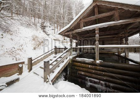 Wooden old-style structure with baptistery in Russian Orthodox Monastery at winter