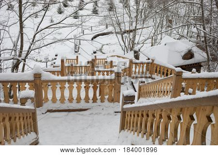 Wooden stairs with carving in Russian Orthodox Monastery at winter day