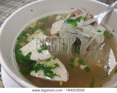 Healthy eating meal Pho noodle with boiled pork for light breakfast or lunch in restaurant Vietnam noodle soup Recipefocus on foreground with blur background