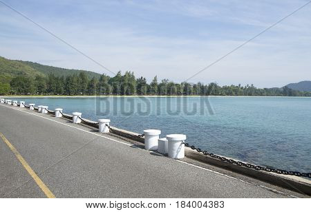 Road side along the beach and blue sea