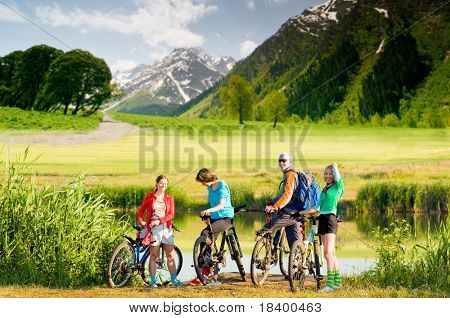 mixed group of cyclists  outdoors