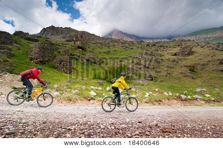 two cyclists relax biking outdoors