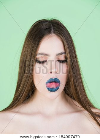 Girl With Black Make Up And Long Hair Showing Tongue