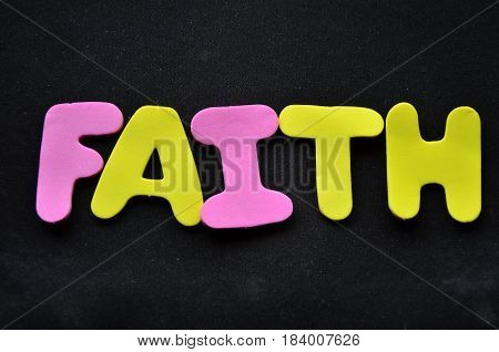 faith word on a  abstract black background