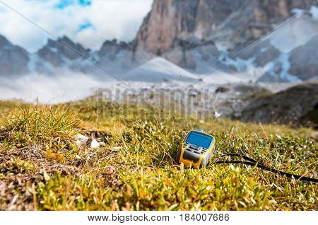 GPS navigator in hand against Dolomites Alps