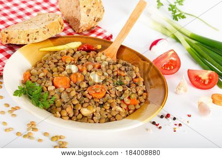 Lentil soup stew meal with lentils in a plate on white background