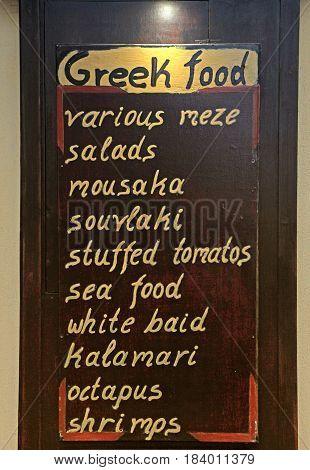 Greek restaurant hand made menu written on the blackboard