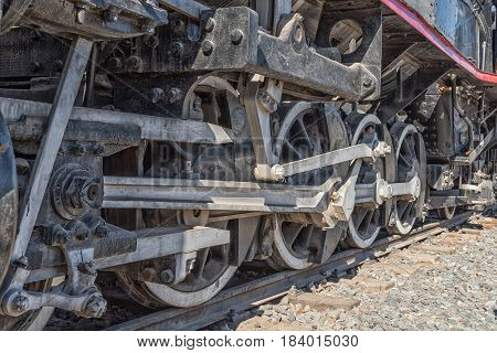 ASHTON SOUTH AFRICA - MARCH 26 2017: The wheels of a class CRB steam engine at Platform 62 a road stall in Ashton a town on the scenic Route 62 in the Western Cape Province