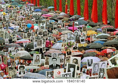 Volgograd Russia - May 9 2015: Procession of local people with photos of their relatives in Immortal Regiment on annual Victory Day on Mamaev Hill in Volgograd