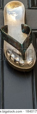 Brass Knocker Shaped Flip-flops, Beautiful Ornament On Brown Wood, Decorative Entry Element Of The H