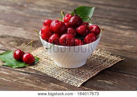 bowl with red cherries, freshly picked cherries concept