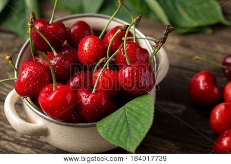 red cherries, cherries on table, bowl with cherries, freshly picked cherries concept