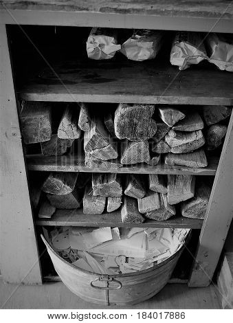 A view of firewood and bucket of paper