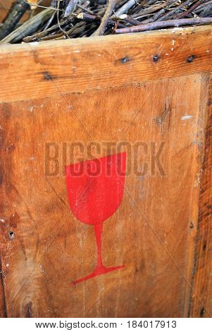 A wine crate, with wood sticks inside