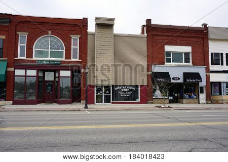 KALKASKA, MICHIGAN / UNITED STATES - NOVEMBER 27, 2016: Businesses in downtown Kalkaska include Edward Jones Investments, Jerry's T.V. and Appliance Service, Forbes Photography, and Kalkaska Floral.