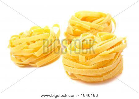 Three Uncooked Pasta Nests