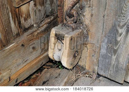 An old, dirty pulley found in a barn