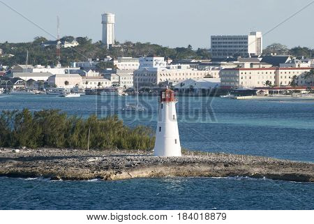 The view of a lighthouse built on Paradise Island with Nassau downtown in a background (Bahamas).