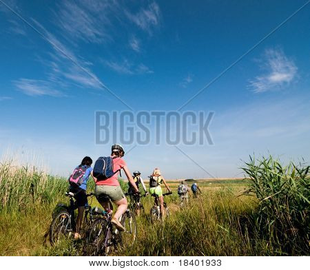 group of cyclists biking