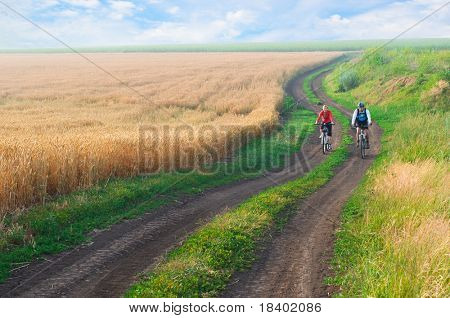 two cyclist relax biking