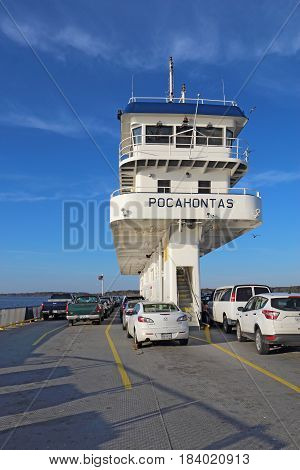 SCOTLAND VIRGINIA - FEBRUARY 20 2017: Cars on deck and the bridge of the Jamestown-Scotland Ferry boat Pocahontas on its way to Jamestown. This historic car ferry has been in operation since 1925.