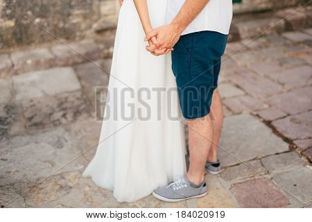 The newlyweds hold hands. Couple holding hands. Wedding in Montenegro.
