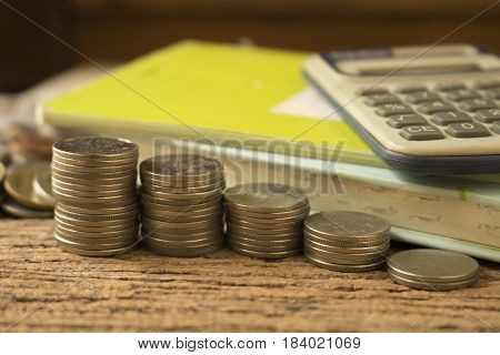 stack of coins with calculator for save money and growth.