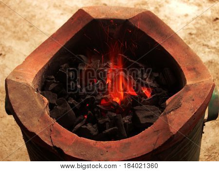 burnning charcoal in stove for cook closeup