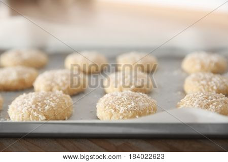 Baking tray with coconut cookies, closeup