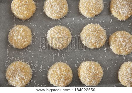Tasty coconut cookies on parchment paper