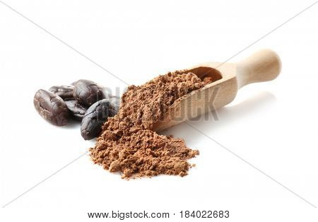 Wooden scoop with aromatic cocoa powder and beans on white background