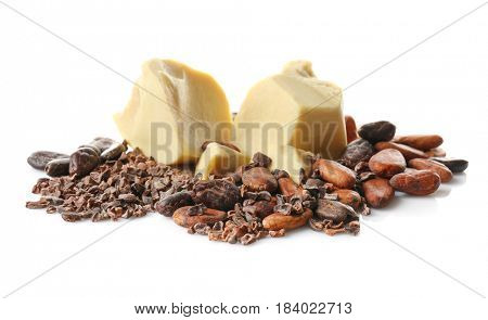 Pile of cocoa beans, butter and nibs on white background