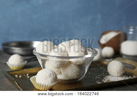 Bowl with coconut candies on metal tray