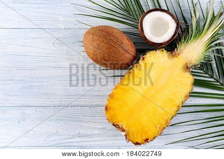 Pineapple and coconut on wooden table